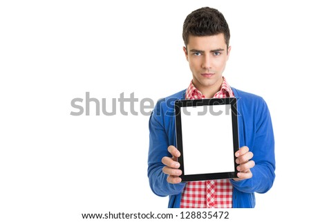 Young fashionable man showing digital tablet with blank screen - stock photo
