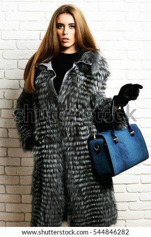 https://thumb9.shutterstock.com/display_pic_with_logo/303289/544846282/stock-photo-young-fashionable-sexy-pretty-rich-woman-with-beautiful-long-blonde-hair-in-waist-coat-of-grey-fur-544846282.jpg