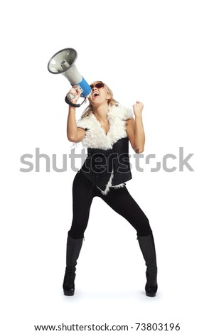 Young fashionable woman shouting in a megaphone