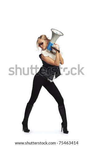 Young fashionable woman with megaphone - stock photo