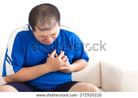 young fat man getting heart attack - stock photo