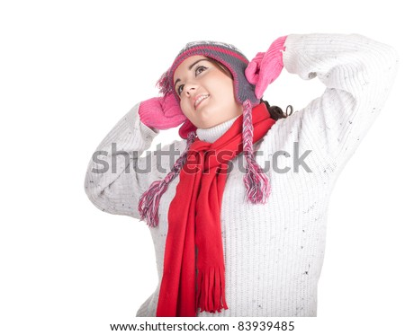 young fat woman in winter hat and mittenswith raised arms, series - stock photo