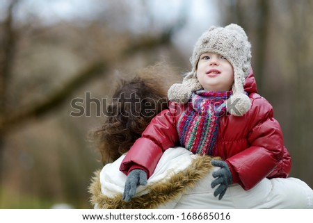 Young father and his adorable daughter at winter - stock photo