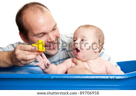 young father and his cute baby playing with duck in the bath, isolated on white background