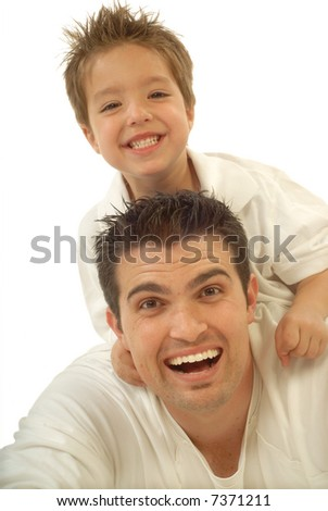 Young father and his toddler son playing around and laughing; isolated on white - stock photo