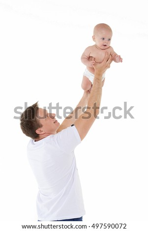 Young father and little baby boy are playing on a white background. Happy family. Six month