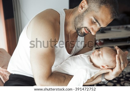 Young father and newborn baby girl.Father Holding newborn baby. Indoors shot, Horizontal - stock photo