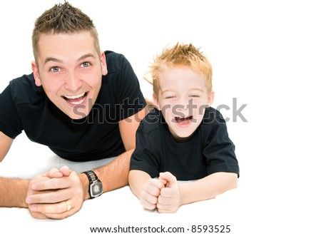 young father and son having a laugh - stock photo