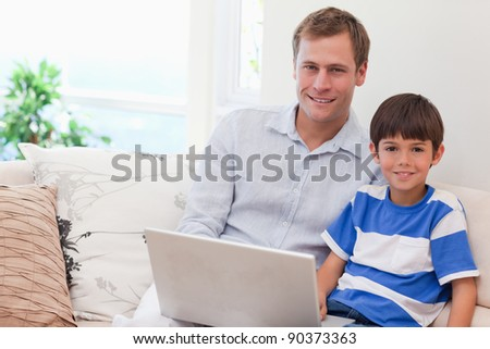 Young father and son playing computer games together