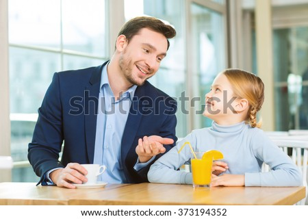 Young father having a conversation with curious daughter. - stock photo