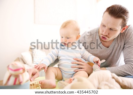 Young father having fun with his little son