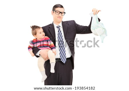 Young father holding a baby and a dirty diaper isolated on white background - stock photo