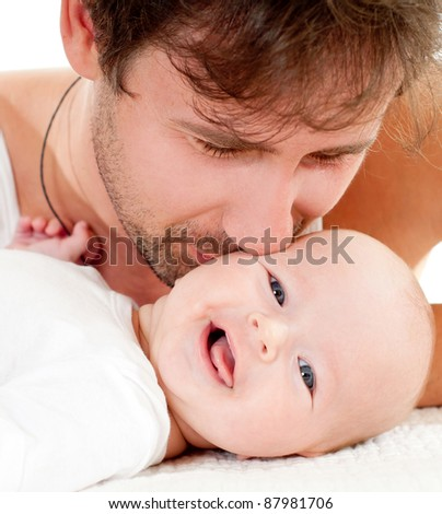 young father holding its lovely daughter