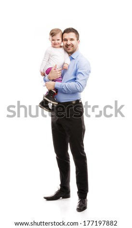 Young father is having fun with his little baby - stock photo