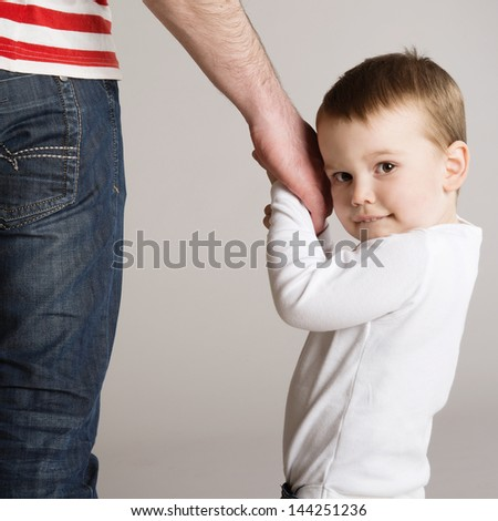 Young father is playing with his son - stock photo