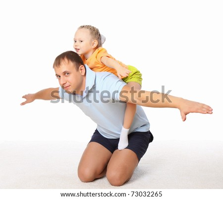 Young father spend time with his little daughter - stock photo