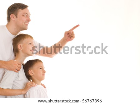 young father with his two sons standing on a white background - stock photo
