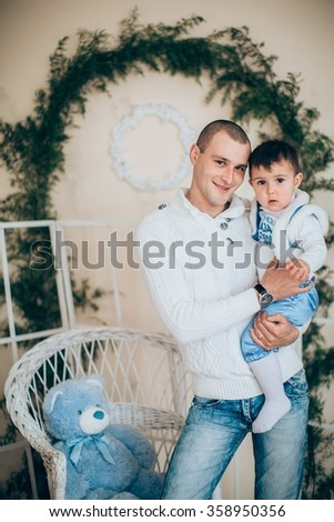 young father with his young son near Christmas tree - stock photo