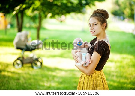 Young father with son outdoors in park