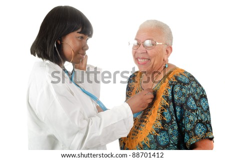 Young female African American nurse or doctor checking elderly African American woman's heart, isolated on white. - stock photo