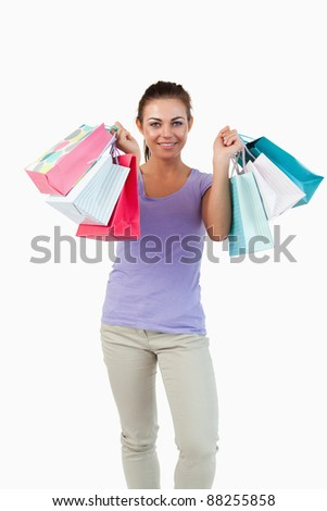 Young female after shopping tour against a white background