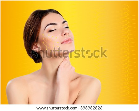Young female and clean fresh skin. The reinforcement with gold thread - stock photo