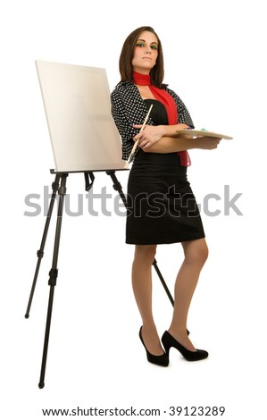Young female artist posing next to a blank canvas
