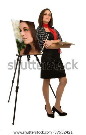 Young female artist posing next to her self-portrait - stock photo