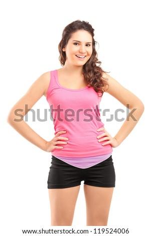 Young female athlete posing isolated against white background - stock photo