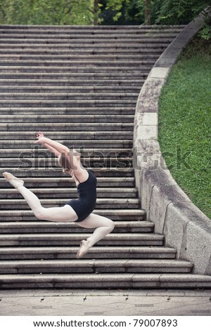 Young female ballerina performing in the outdoors