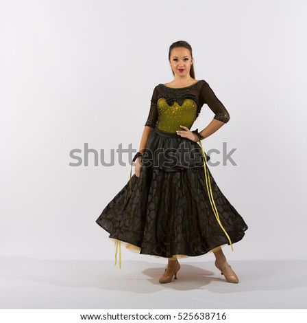 Young female ballroom dancer in studio taken against a high-key white background