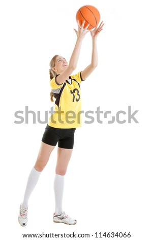 Young female basketball player with a ball - stock photo