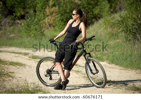 young female biker athlete resting up - stock photo