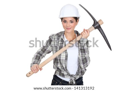 young female bricklayer holding pickaxe