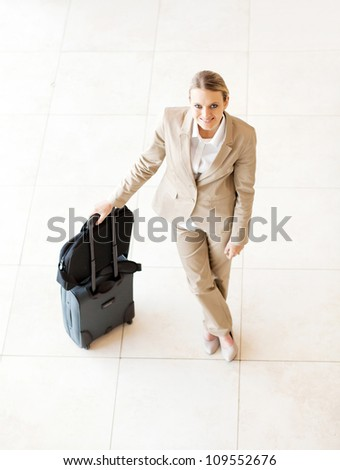 young female business traveller portrait - stock photo
