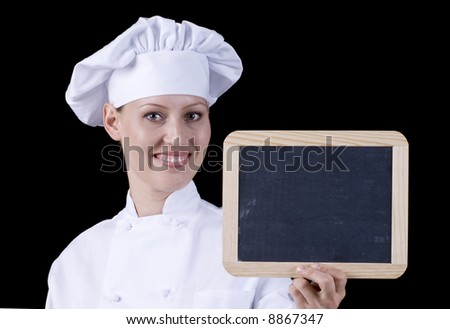 Young Female Chef Holding a Blank Chalk Board (Add Your Message) - stock photo