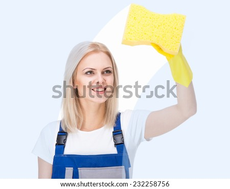Young female cleaner is cleaning on white background. - stock photo