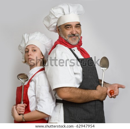 young female cook and chef - stock photo