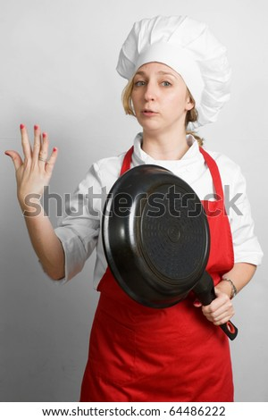 young female cook with flying pan