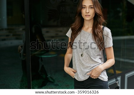 Young female coucasian model in casual style at the city street - stock photo