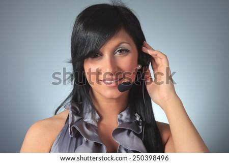 Young female customer service representative in headset. - stock photo
