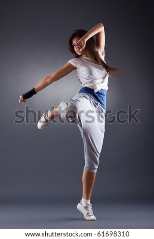 young female dancing jazz modern dance on a dark background