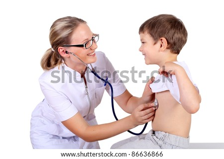Young female doctor doing medical examination to a child - stock photo
