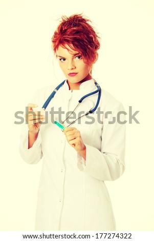 Young female doctor or nurse holding syringe , isolated on white. - stock photo