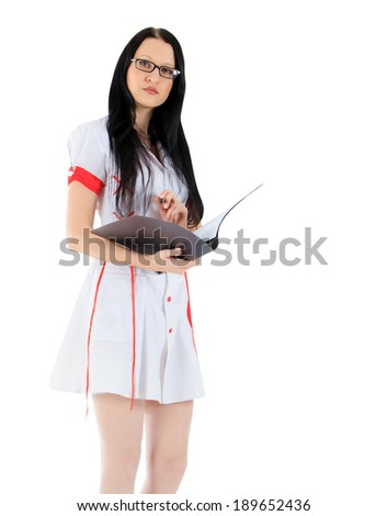 Young female doctor standing with clipboard over white - stock photo