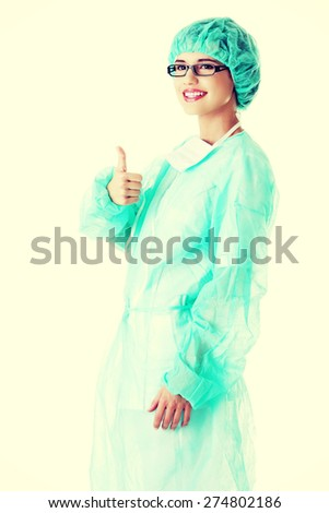 Young female doctor wearing protective clothing - stock photo