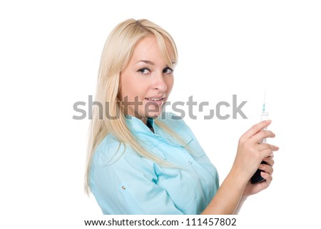 Young female doctor with a syringe and cell phone in a hand.isolated over white - stock photo