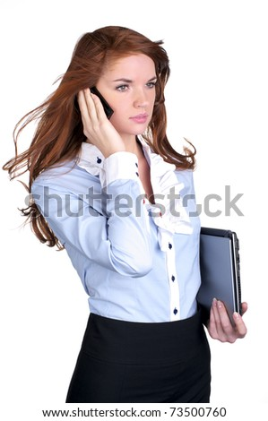 Young female executive talking on cellphone - stock photo