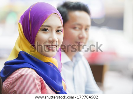 Young female executive with her business Colleagues - stock photo