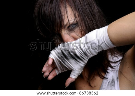young female fighter ready for boxing - stock photo